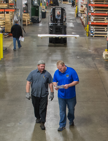 Two employees walking in the warehouse