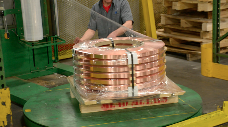 Mead Metals employee packaging a material shipment